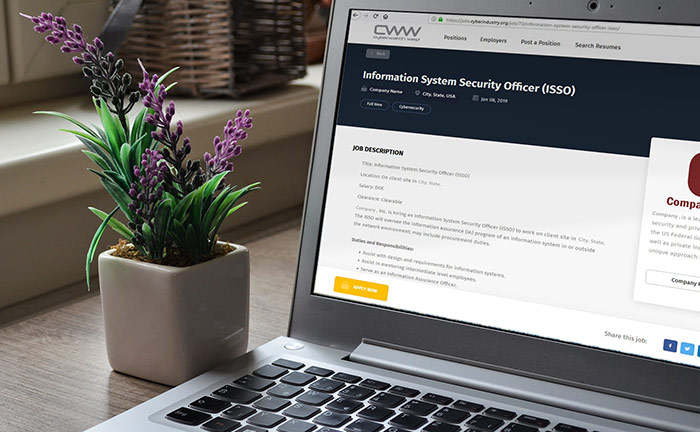 photograph of a laptop with the CyberIndustry Job Board website open. A flower pot is beside the computer screen.